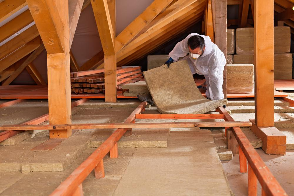 Worker Applying Insulation to Attic