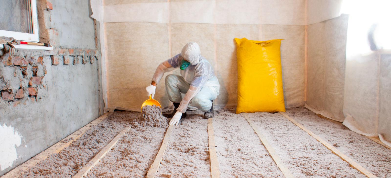 Worker Applying Cellulose Insulation